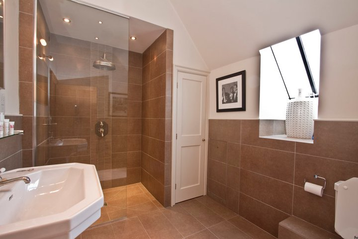 master en suite kitted out with a huge rain shower and super